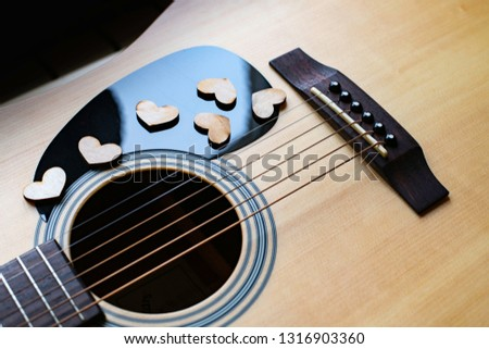 Wooden hearts on guitar, on pic guard.  Love music concept.