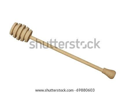 wooden honey drizzler on white background