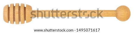 wooden honey stick isolated on white background. #1495071617