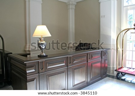 Wooden hotel reception desk, in British Colonial style