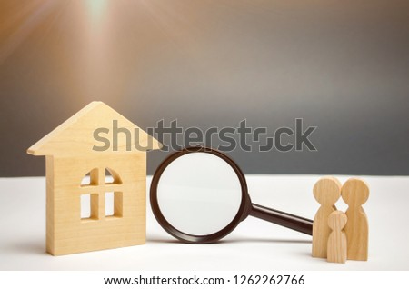 Wooden house and magnifying glass with family. Property valuation. Choice of location for the construction. House searching concept. Search for housing and apartments. Real estate concept. Appraisal