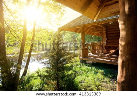 Wooden house and pond