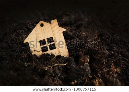 Wooden house falls into ground. under the ground home mortgage, house for sale, real estate crisis concept, copy space. owe, indebted. Mortgage crisis. defaulter loses real estate. loss mortgaged home Сток-фото ©