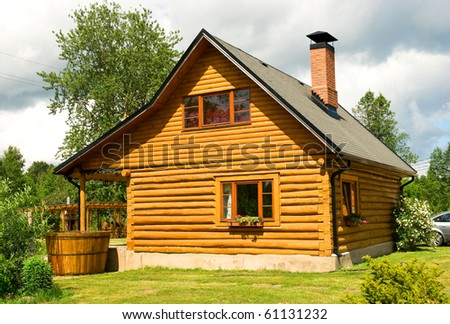 Wooden house for rest with a sauna and the big wooden font