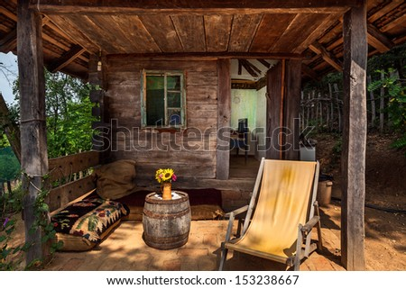 Wooden house in forest, house made of natural materials.