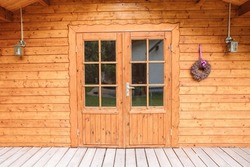 Wooden house in the garden or in the forest. Build with wood. Garden shed
