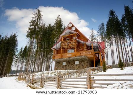 Wooden house in the winter in Carpathians