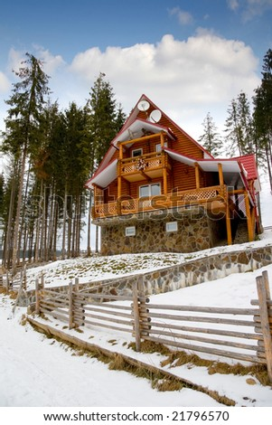 Wooden house in the winter in Carpathians