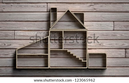 wooden house silhouette on wooden background
