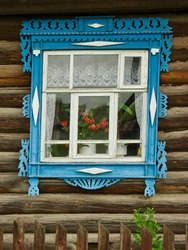 Wooden house with carved architraves on the windows.