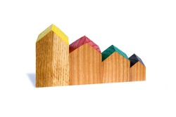 Wooden houses in a row. Schedule of house sales decline. Mortgage. Contribution to real estate. Buying a house. Decline in the real estate market. Mortgage loan. Histogram of the decrease in sales .