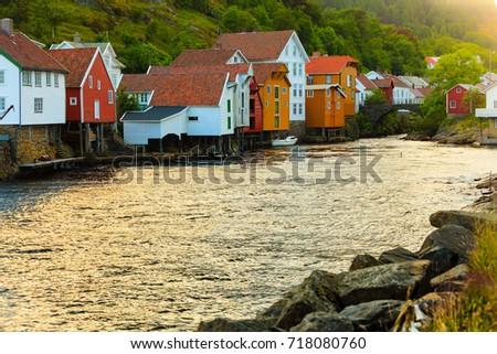 wooden houses in harbor village ...
