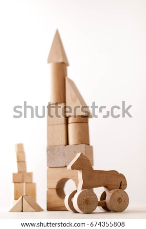 wooden houses made from  different wooden shapes and forms for kids skills developments #674355808