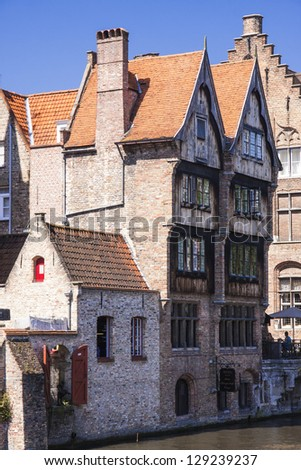 Wooden houses near canal in Bruges