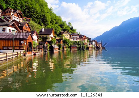 Wooden houses of Hallstatt, Austria with reflections in lake Hallstatter See