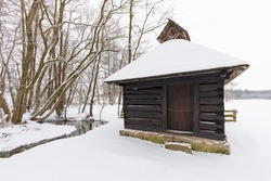 Wooden houses of Vesely Kopec folk museum. Czech rural architecture. Vysocina, Czech Republic. Traditional wooden timbered cottage in winter. Folk open air museum. Most popular place in highlands.