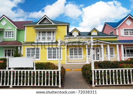Wooden houses painted in Caribbean  colors in Samana resort, Dominican Republic