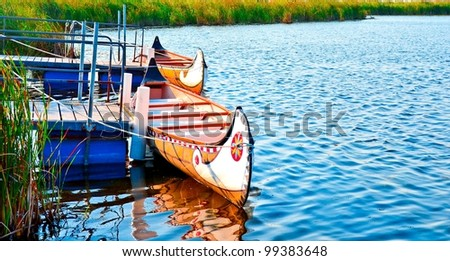 wooden indian canoe on a blue lake
