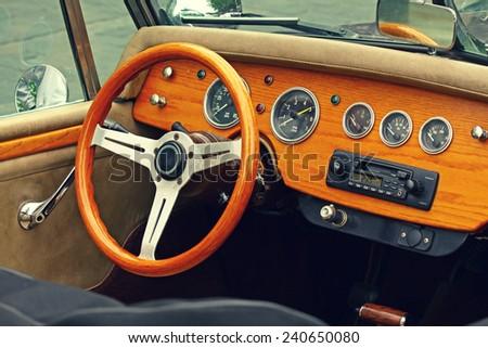 Wooden interior of antique luxury car. Retro feel photographic effect