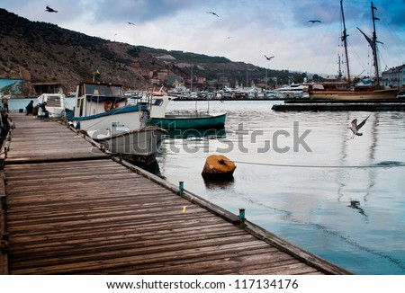 Wooden jetty and fishing boats