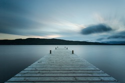 Wooden jetty at sunset, Lake Windermere in the English Lake District (UK)