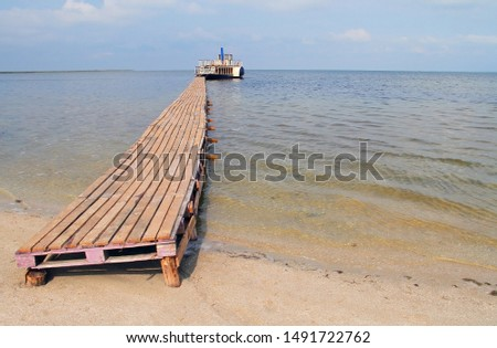 wooden jetty for a pleasure boat