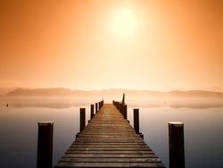 wooden jetty in morning fog