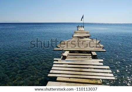 wooden jetty into the sea