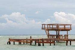 Wooden jetty on Roatan beach. Roatan, Honduras