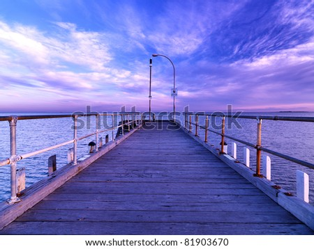 Wooden jetty over the beautiful sea Altana, with blue sky