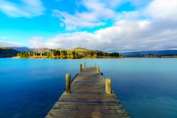Wooden Jetty pier at Lake Dunstan in Cromwell town, Central Otago, Otago region, South Island, New Zealand.