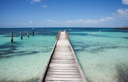 Wooden jetty reaching into the turquoise, green Indian Ocean waters at Rottnest Island in Western Australia/Jetty into the Sea/Rottnest Island, Western Australia