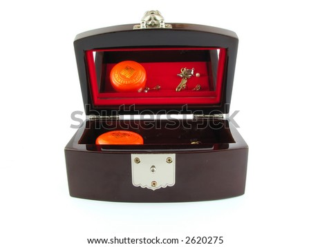 Wooden jewel box with a mirror showing its contents, isolated on white.