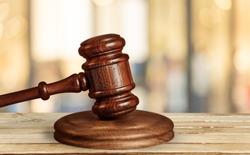Wooden judge gavel on wood desk