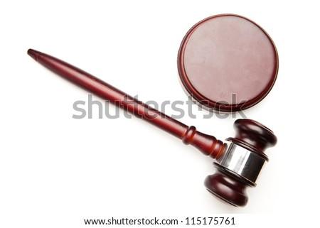 Wooden judge's gavel lying against white background