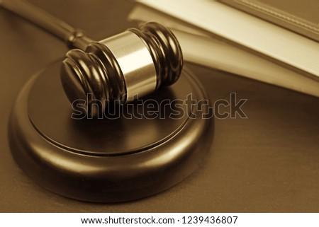 Wooden judgement or auction mallet. Conceptual image.