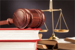 Wooden justice gavel on stack books