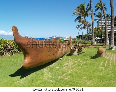wooden kayak on a beach