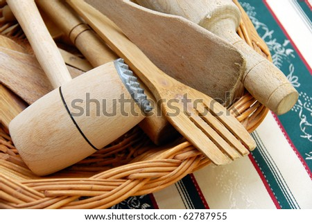 wooden kitchen equipment, meat hummer and scoops closeup on table #62787955