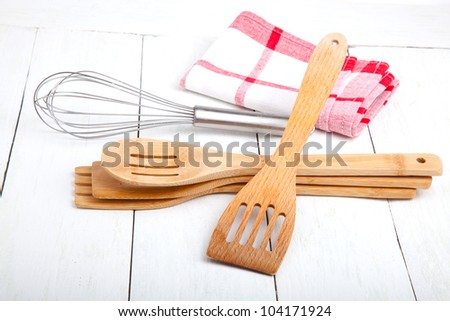 Wooden kitchen set with tea towel, on wooden white background.