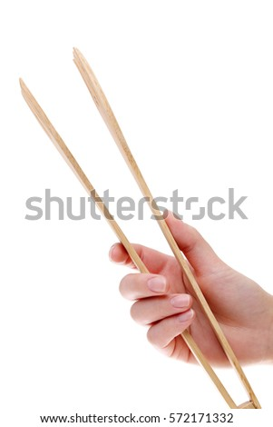 Wooden kitchen tongs isolated on a white background  Zdjęcia stock ©