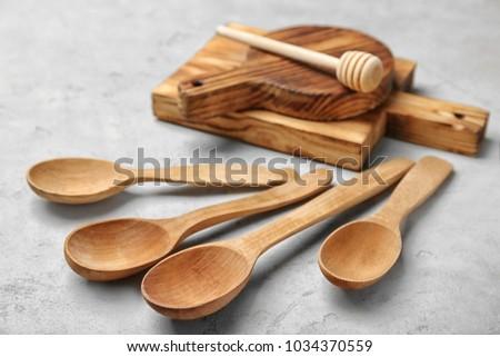Wooden kitchen utensils on table #1034370559