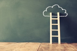 wooden ladder and cloud info graphics on blackboard background. retro filtered