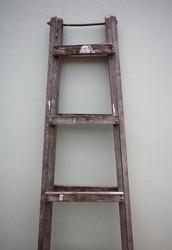 Wooden Ladder near gray