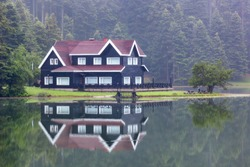 Wooden Lake house inside forest in Bolu Golcuk National Park, Turkey wallpaper