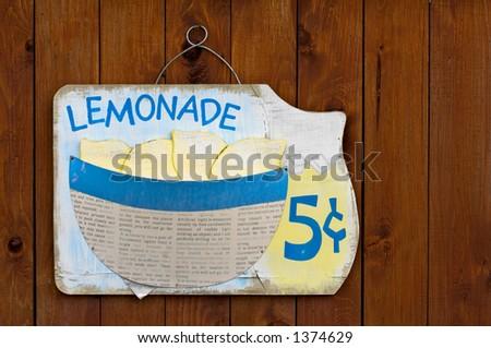 Wooden lemonade sign on wood fence - stock photo