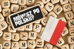 Wooden letters, flag of poland and polish translation for question Do you speak polish