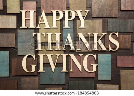 Wooden letters forming words HAPPY THANKS GIVING written on wooden background
