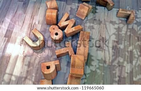 wooden letters on wooden floor