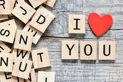 Wooden letters spelling I love you with red heart